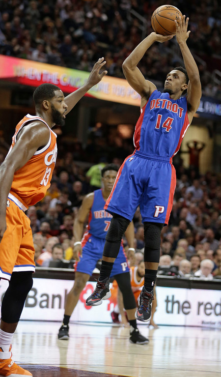 . Detroit Pistons\' Ish Smith (14) shoots over Cleveland Cavaliers\' Tristan Thompson (13) in the second half of an NBA basketball game, Tuesday, March 14, 2017, in Cleveland. (AP Photo/Tony Dejak)