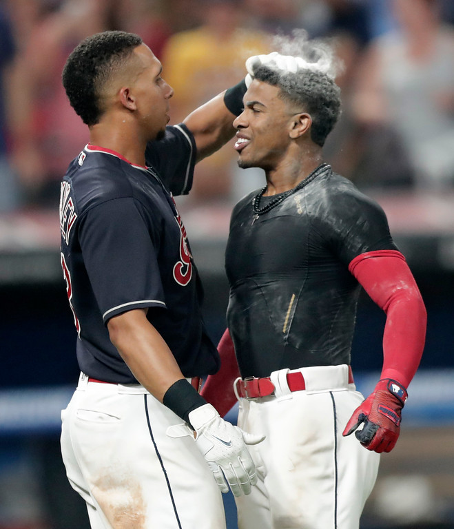. Cleveland Indians\' Michael Brantley pats Francisco Lindor on the head after Lindor hit a walk-off three-run home run against the Minnesota Twins in a baseball game Wednesday, Aug. 8, 2018, in Cleveland. The Indians won 5-2. (AP Photo/Tony Dejak)