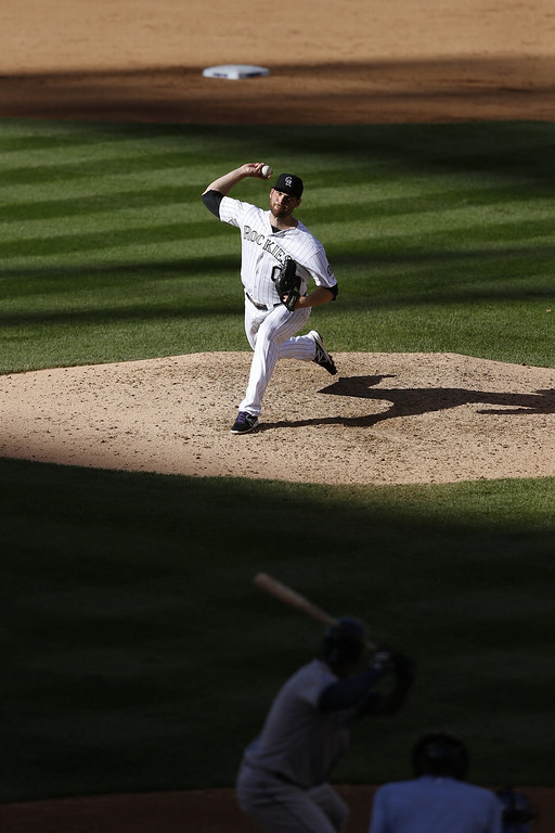 . Adam Ottavino #0 of the Colorado Rockies pitches in the eighth inning of the game against the San Diego Padres at Coors Field on September 7, 2014 in Denver, Colorado. The Rockies won 6-0. (Photo by Joe Robbins/Getty Images)