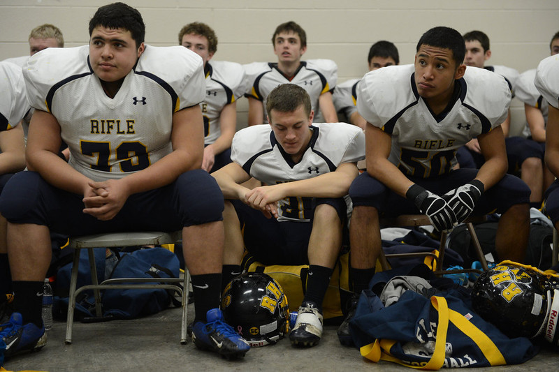 . Rifle players listen to a pep talk before the Class 3A Championship football game, Saturday December 01, 2012.  The Silver Creek Raptors beat  the Rifle Bears 32 - 15 at Legacy Stadium in Aurora, CO. Craig F. Walker, The Denver Post