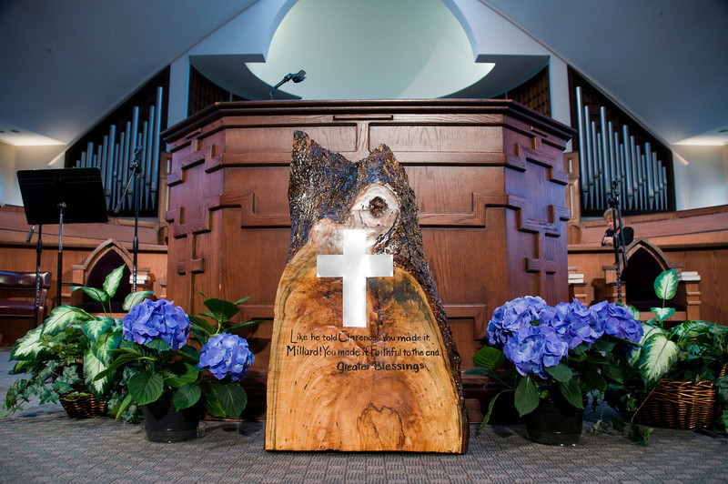 """Nashua Chantal of Koinonia handcrafted a cross section of a pecan tree and Inscribed it with """"Like he told Clarence. You made it Millard! You made it Faithful to the end. Greater Blessings""""  sh"""