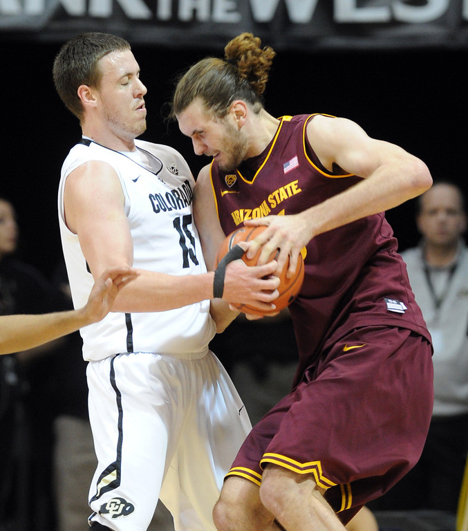 . Arizona State\'s Jordan Bachynski, right, runs into Colorado\'s Shane Harris-Tunks during the first half of an NCAA college basketball game on Saturday, Feb. 16, 2013, in Boulder, Colo. (AP Photo/Daily Camera, Cliff Grassmick)