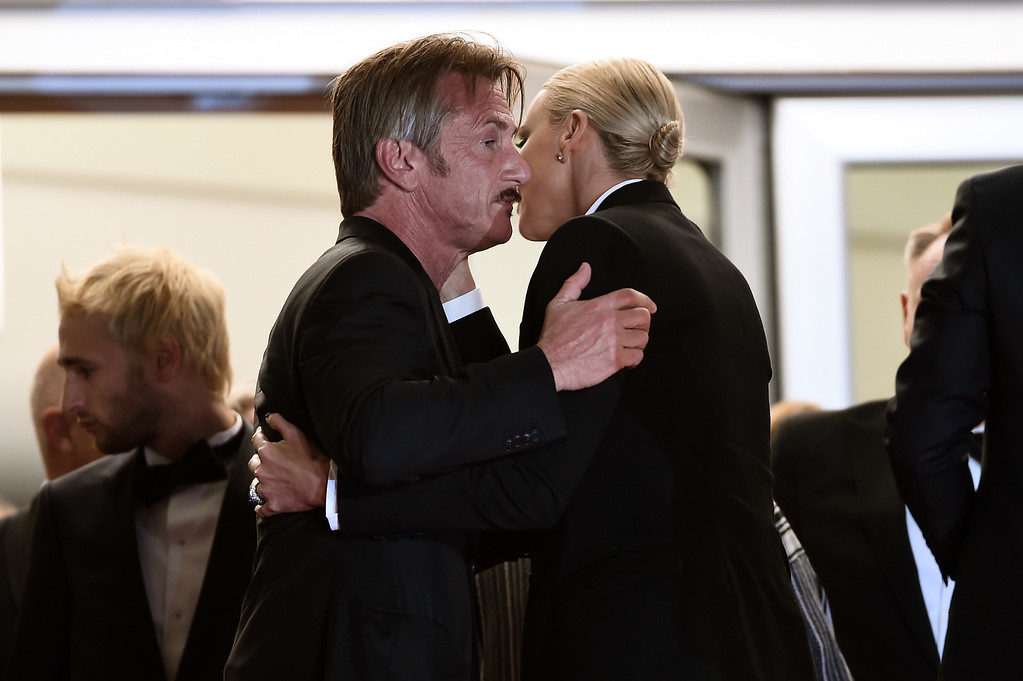 ". Sean Penn and Charlize Theron embrace each other as they leave the screening of ""The Last Face\""  at the annual 69th Cannes Film Festival at Palais des Festivals on May 20, 2016 in Cannes, France.  (Photo by Ian Gavan/Getty Images)"