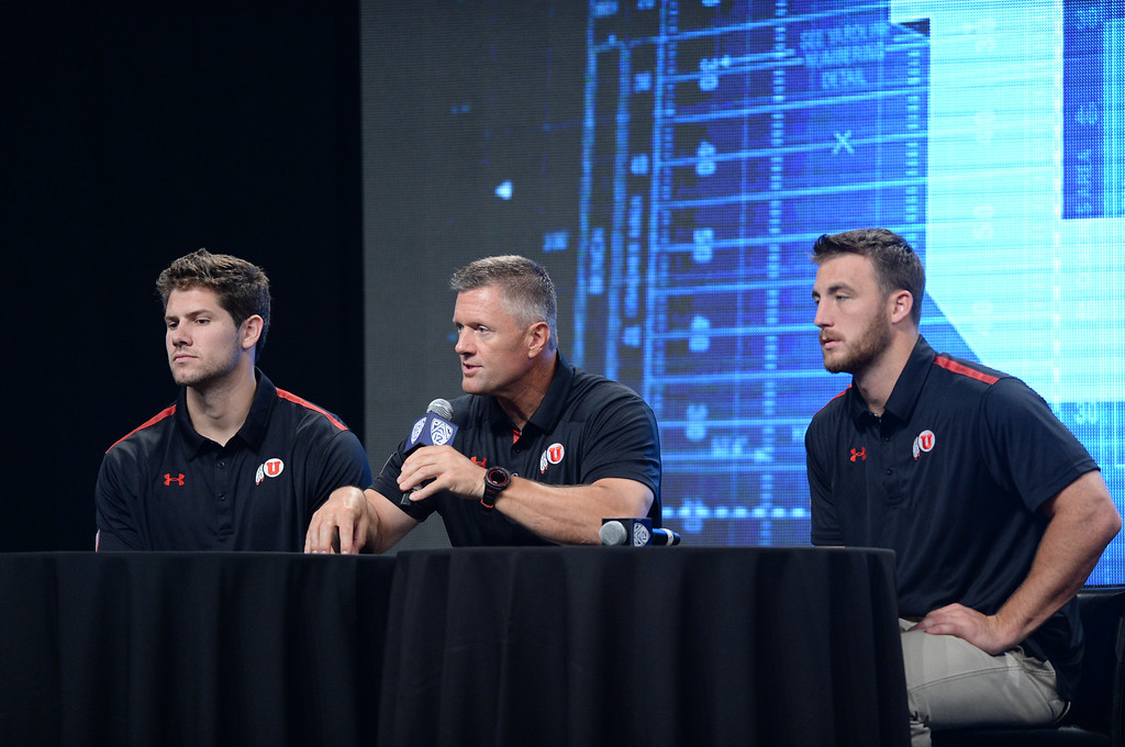 . Utah Coach Kyle Whittingham with players Jake Murphy, left and Trevor Reilly, right. Pac12 media Day at Sony Studios.  Photo by Brad Graverson 7-26-13