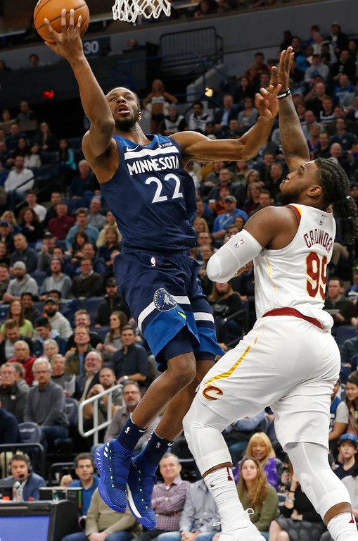 . Minnesota Timberwolves\' Andrew Wiggins, left, lays up a shot as Cleveland Cavaliers\' Jae Crowder defends in the first half of an NBA basketball game Monday, Jan. 8, 2018, in Minneapolis. (AP Photo/Jim Mone)