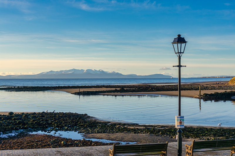Looking over from the Irvine redeveloped Harbourside across the old harbour to the snow covered Isle of Arran in the far frozen hazy distance.