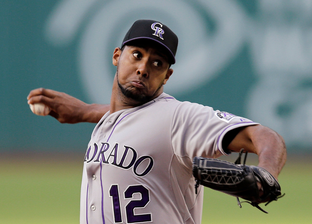 . Colorado Rockies starting pitcher Juan Nicasio delivers against the Cleveland Indians in the first inning of a baseball game Friday, May 30, 2014, in Cleveland. (AP Photo/Mark Duncan)