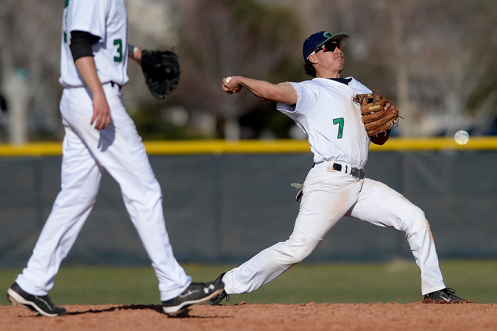. Aurora, CO - APRIL 08: Vincent Lopez (7) of the Overland Trailblazers fields the final out of the sixth inning on a ball hit by Grant Farrell (16) of the Cherry Creek Bruins. Overland hosted Cherry Creek on Tuesday, April 8, 2014. (Photo by AAron Ontiveroz/The Denver Post)