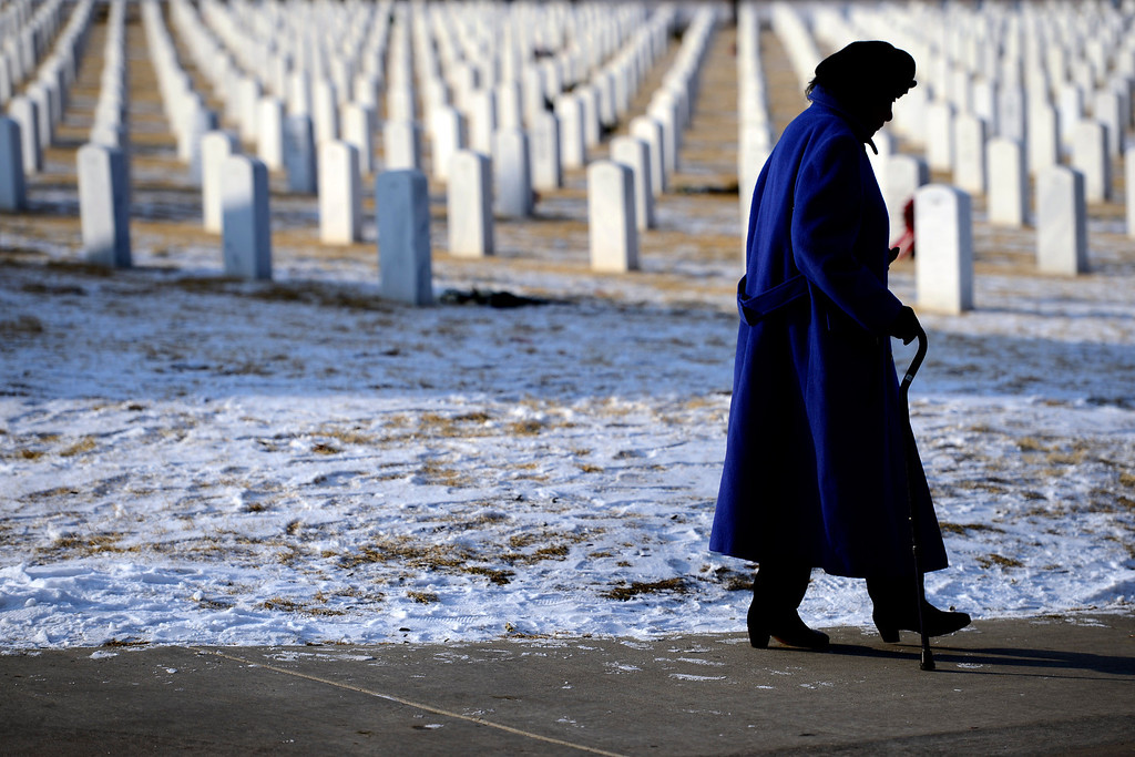 . A woman leaves the services for Colonel Fitzroy Newsumduring at Fort Logan National Cemetery on Monday, January 14, 2013. Newsum, who was 94, served as a Tuskegee Airman during his military service. AAron Ontiveroz, The Denver Post