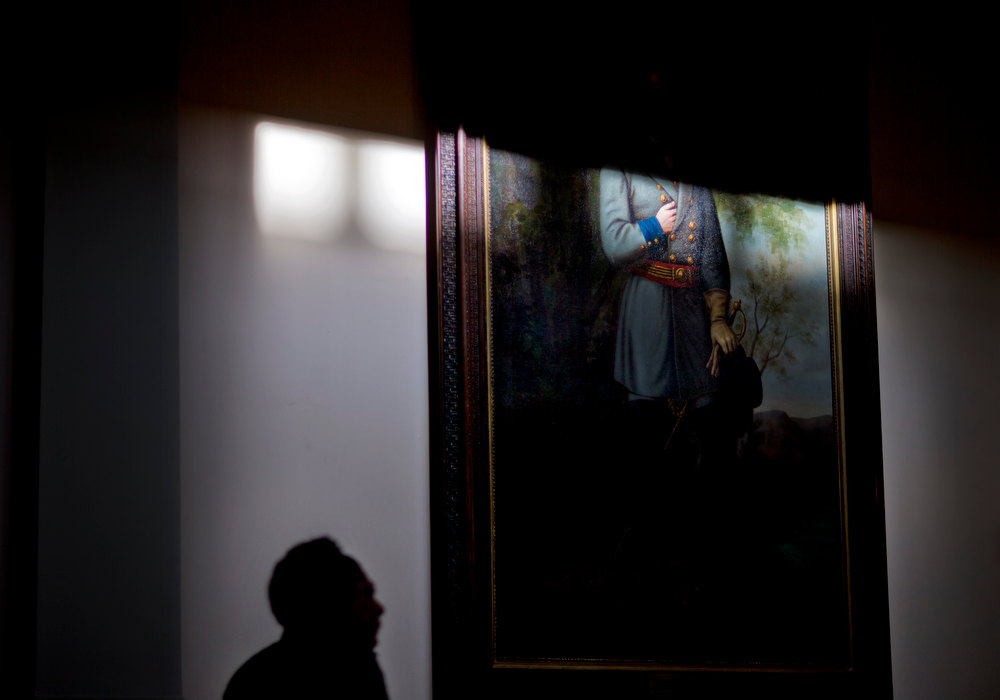 . In this Thursday, Jan. 3, 2013 file photo, a clerk walks past a portrait of Confederate Gen. Robert E. Lee in the rotunda of the Georgia State Capitol in Atlanta. (AP Photo/David Goldman)