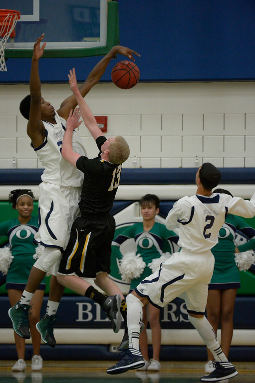 . AURORA, CO - FEBRUARY 12: Overland De\'Ron Davis (20) blocks a shot by Arapahoe Brendan Till (13) during their 5A basketball game February 12, 2014 in Aurora. (Photo by John Leyba/The Denver Post)