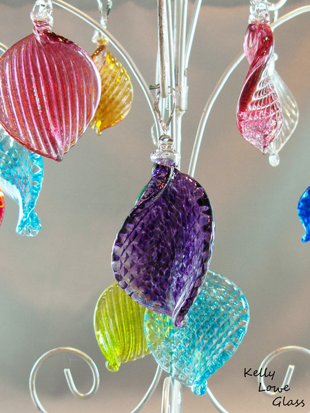Hand Sculpted Hanging Ornaments:  These glass ornaments are made to play with light in a way that will draw attention and add to any festive decor. Hang them from a Christmas Tree, on doors, from lights, from your nostrils, or go ahead and wear them as as kinda smallish and not very practical hat - I know you want to.
