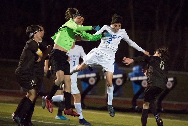 11/19/19 Wesley Bunnell | StaffrrPlainville boys soccer was defeated by Stonington in a Class M playoff game at Ken Strong Stadium in West Haven on Tuesday evening. Tanner Rau (2).