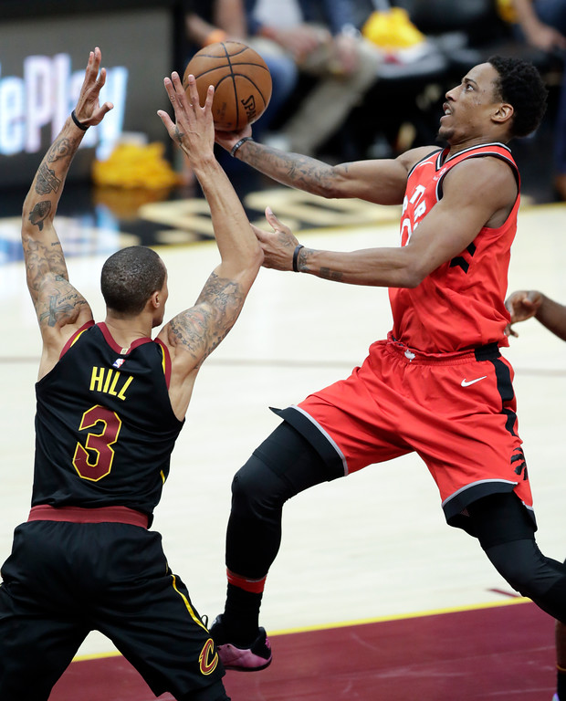 . Toronto Raptors\' DeMar DeRozan shoots against Cleveland Cavaliers\' George Hill (3) in the second half of Game 4 of an NBA basketball second-round playoff series, Monday, May 7, 2018, in Cleveland. (AP Photo/Tony Dejak)