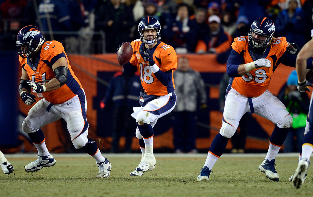 . Denver Broncos quarterback Peyton Manning (18) looks for a receiver during the second half.  The Denver Broncos vs. the San Diego Chargers at Sports Authority Field at Mile High in Denver on December 12, 2013. (Photo by AAron Ontiveroz/The Denver Post)