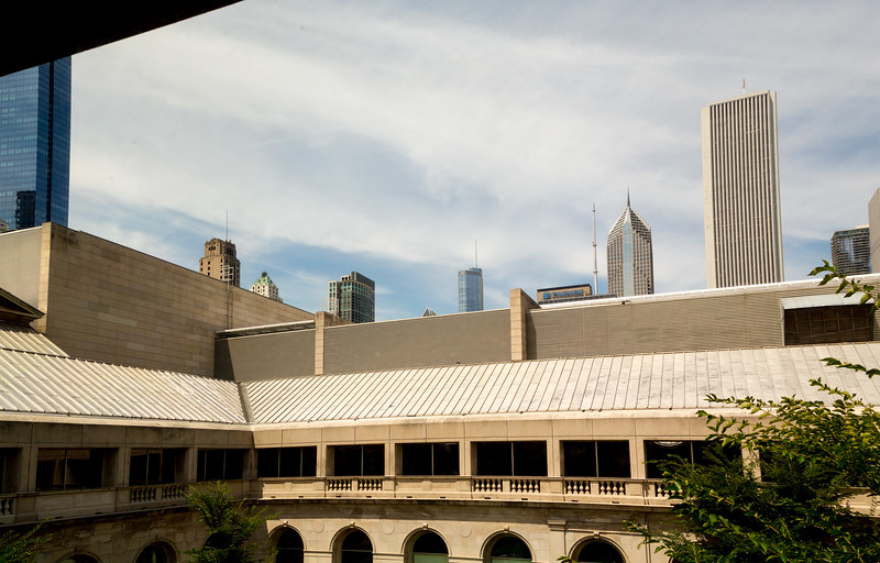 The Chicago skyline peeks over the edge of the Art Institute's courtyard.