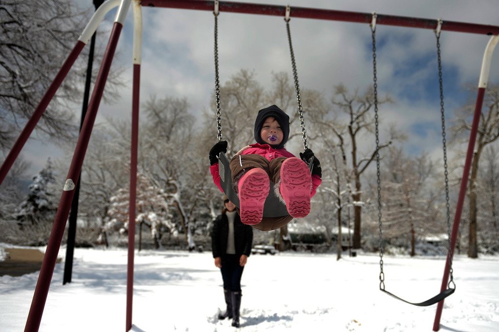 ". BOULDER, CO. - APRIL 23: 2 year old Quinn Hamling swinging with his mom Carlisle of Venice Beach CA. ""We\'re here for 48 hours,\"" said Carlisle. \""The snow came at the perfect time.\""  April 23, 2013 Boulder, Colorado. (Photo By Joe Amon/The Denver Post)"