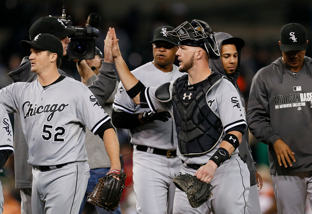 . Chicago White Sox catcher Tyler Flowers celebrates with teammates after beating the Detroit Tigers 2-0 in a baseball game in Detroit Monday, Sept. 22, 2014. The White Sox won 2-0. (AP Photo/Paul Sancya)