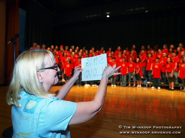 Lopatcong Township, NJ, 6/4/2008: Lopatcong Township Middle School teacher, Valerie Mamrak, urges the school's fifth grade students to sing loud during their closing song at their D.A.R.E. Graduation ceremony Wednesday night. (Photo by: Tim Wynkoop)