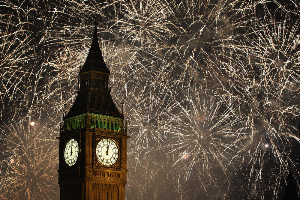 . Fireworks light up the London skyline and Big Ben just after midnight on January 1, 2012 in London, England. Thousands of people lined the banks of the River Thames in central London to ring in the New Year with a spectacular fireworks display.  (Photo by Dan Kitwood/Getty Images)