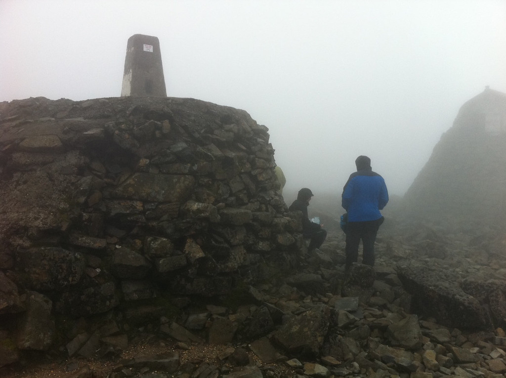 . This October 2013 photo shows the summit of Ben Nevis, near Fort William, Scotland. At 4,400 feet, it\'s the highest mountain in all of Britain. In foggy conditions, it takes a half-hour or more to emerge from the clouds as you descend the trail. (AP Photo/Cara Anna)
