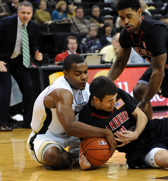 Tony Chenault fights for loose ball.jpg