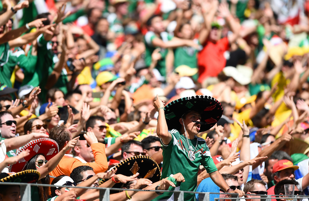 . Mexico fans cheer during the 2014 FIFA World Cup Brazil Round of 16 match between Netherlands and Mexico at Castelao on June 29, 2014 in Fortaleza, Brazil.  (Photo by Laurence Griffiths/Getty Images)