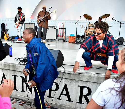 10/24/2019 Mike Orazzi | StaffrDaniel Senior takes a try singing with the rLatanya Farrell Band during the Lights On Afterschool event at Walnut Hill Park organized by the Youth and Workforce Group of the Coalition for New Britains Youth on Thursday evening.
