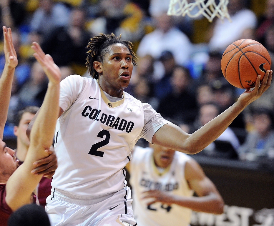 . Xavier Johnson of CU goes strong to the basket against Elon during the second half of the December 13, 2013 game in Boulder. (Cliff Grassmick/Boulder Daily Camera)