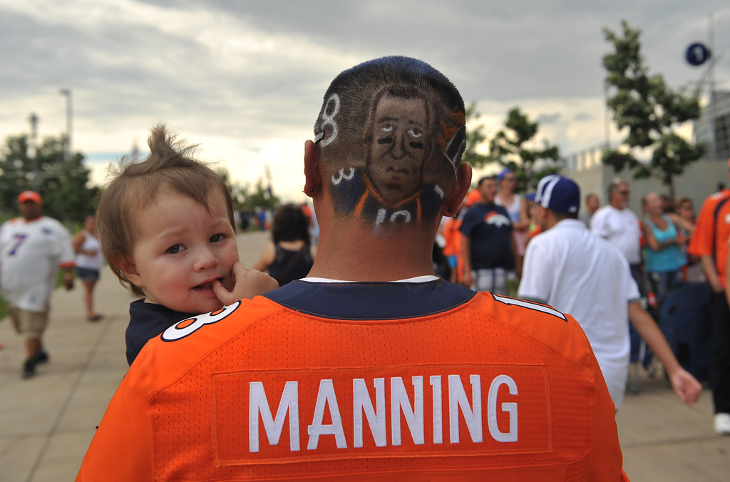 . DENVER, CO. - August 03: Payton Manning fan Jacob Luna is in Sports Authority Field at Mile High for the Denver Broncos Summer scrimmage with his daughter Tiana, age 2. Denver, Colorado. August 03, 2013. (Photo By Hyoung Chang/The Denver Post)