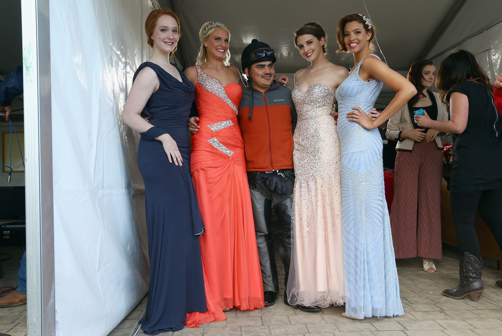 . Models pose for a picture with an exercise rider during the morning training for the Kentucky Derby at Churchill Downs on May 1, 2014 in Louisville, Kentucky.  (Photo by Andy Lyons/Getty Images)