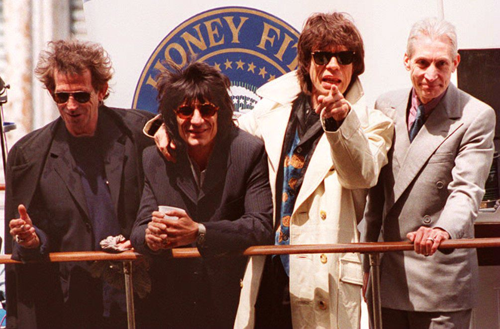 """. The Rolling Stones (L-R) Keith Richards, Ron Wood, Mick Jagger and Charlie Watts arrive by yacht at Chelsea Piers 03 May 1994 in New York to kick-off their \""""Voodoo Lounge \"""" world tour 01 August. It is also the first time the Stones have toured without their bass player Bill Wyman, who left the group last year. (Photo credit should read TIMOTHY CLARY/AFP/Getty Images)"""