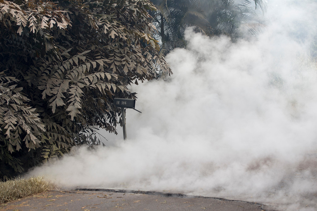 . Volcanic gases pour out of a fissure in the Leilani Estates, Saturday, May 5, 2018, in Pahoa, Hawaii. The powerful gases destroyed the nearby vegetation. The Hawaiian Volcanoes Observatory said eight volcanic vents opened in the Big Island residential neighborhood of Leilani Estates since Thursday. (AP Photo/Marco Garcia)