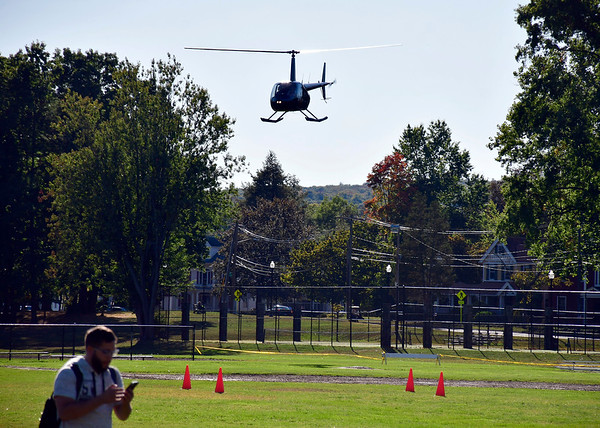 10/5/2019 Mike Orazzi | StaffrThe helicopter comes in for a landing while giving rides during Main Street USA in Walnut Hill Park in New Britain on Saturday.