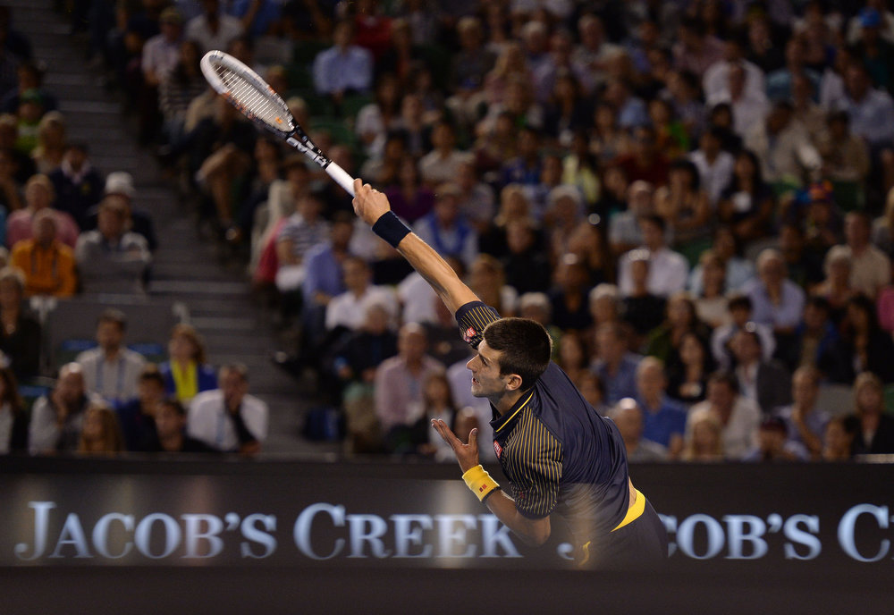 . Serbia\'s Novak Djokovic serves to Britain\'s Andy Murray during the men\'s final at the Australian Open tennis championship in Melbourne, Australia, Sunday, Jan. 27, 2013. (AP Photo/Andrew Brownbill)