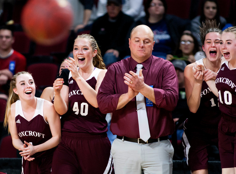 BANGOR, Maine -- 02/22/2017 -- Foxcroft Academy celebrates after defeating Presque Isle during their Class B girls basketball semifinal game at the Cross Insurance Center in Bangor Wednesday. Ashley L. Conti | BDN