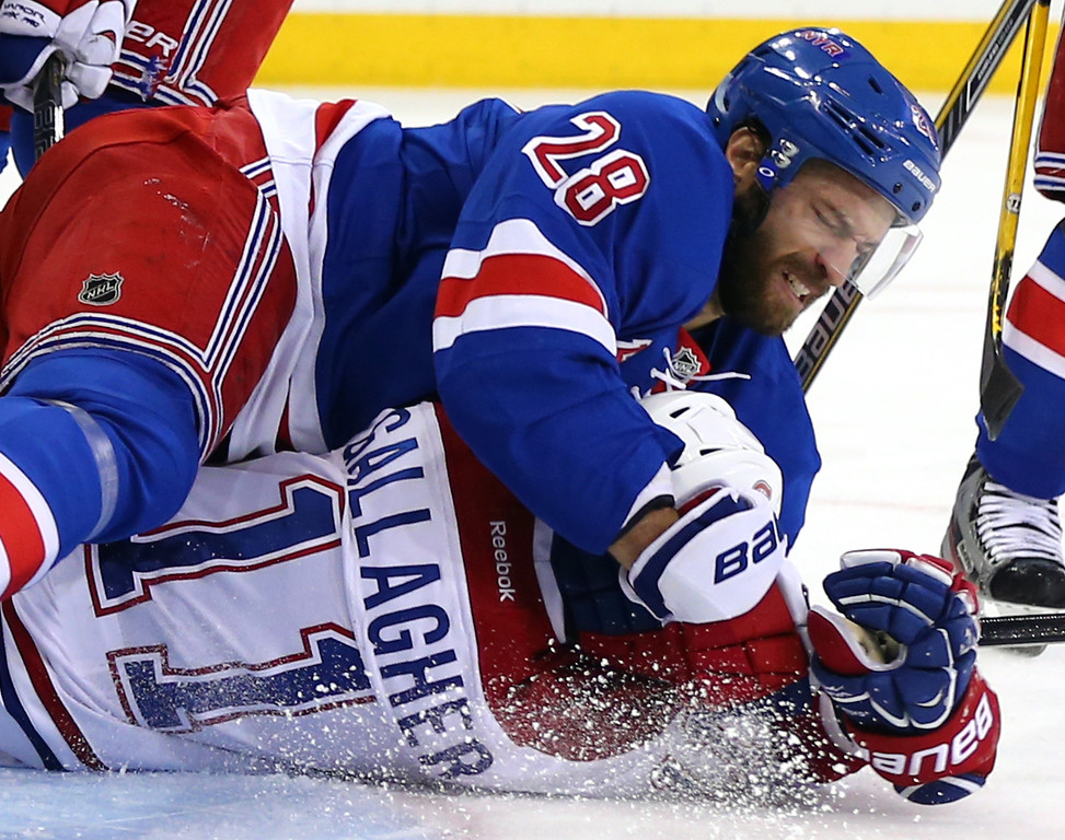 . Dominic Moore #28 of the New York Rangers throws Brendan Gallagher #11 of the Montreal Canadiens to the ice in the first period during Game Four of the Eastern Conference Final in the 2014 NHL Stanley Cup Playoffs at Madison Square Garden on May 25, 2014 in New York City.  (Photo by Elsa/Getty Images)