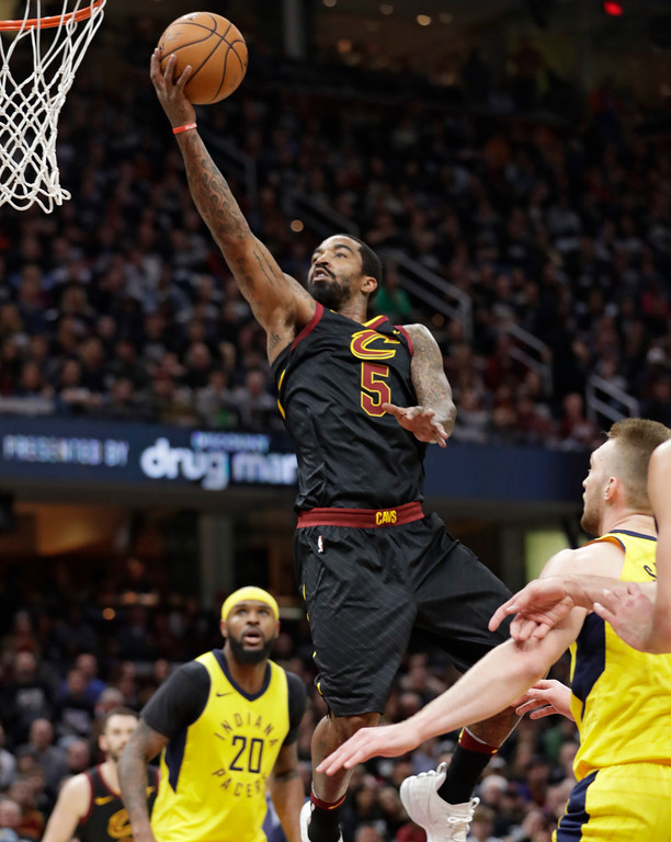 . Cleveland Cavaliers\' JR Smith (5) drives to the basket against the Indiana Pacers in the first half of Game 1 of an NBA basketball first-round playoff series, Sunday, April 15, 2018, in Cleveland. (AP Photo/Tony Dejak)