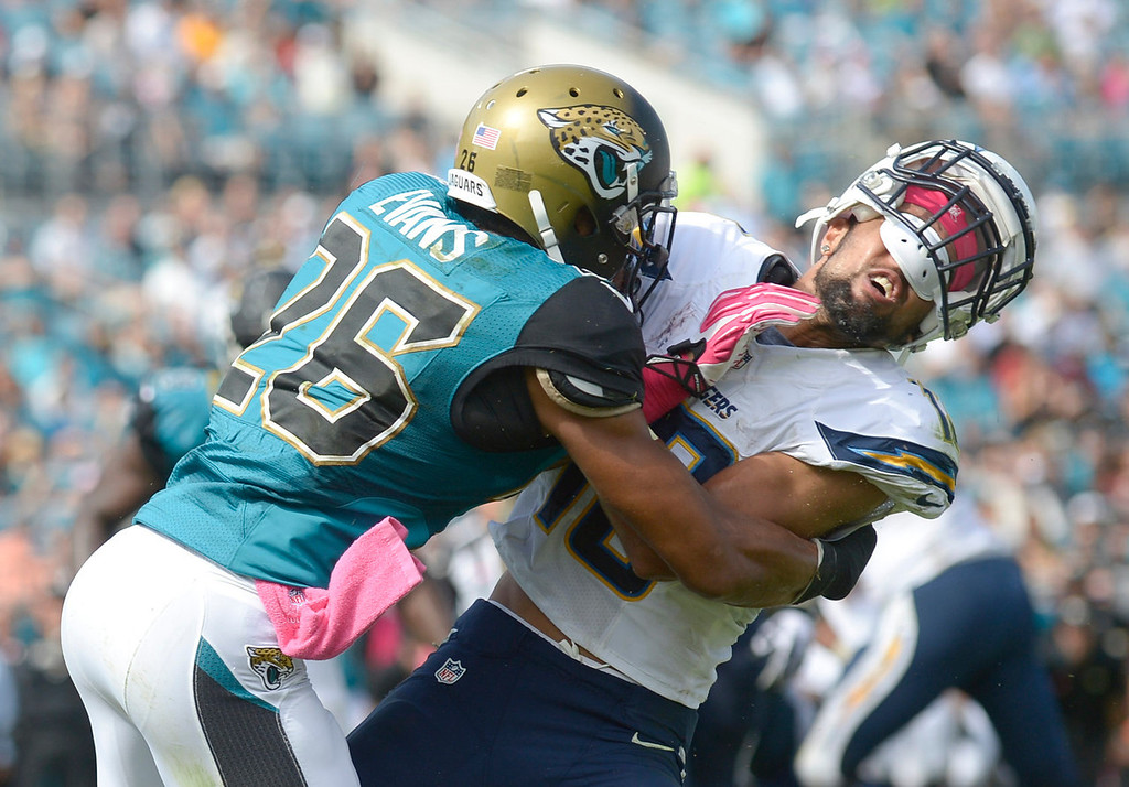 . Jacksonville Jaguars free safety Josh Evans (26) is called for a personal foul as he hits San Diego Chargers wide receiver Keenan Allen in the endzone during the first half of an NFL football game in Jacksonville, Fla., Sunday, Oct. 20, 2013.(AP Photo/Phelan M. Ebenhack)