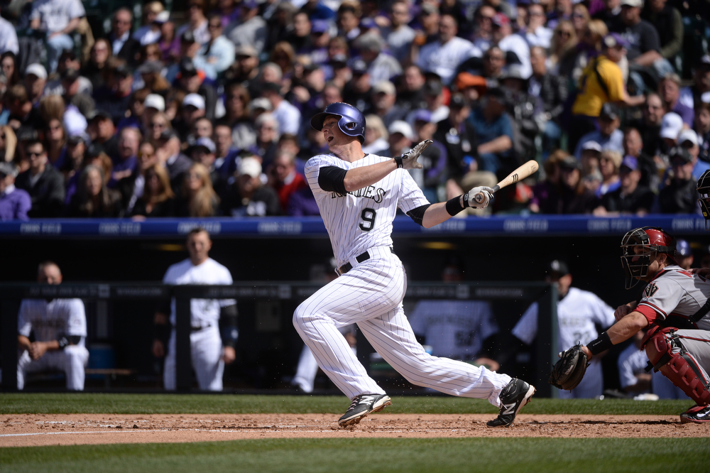 . DENVER, CO. - APRIL 4: The Rockies\' DJ LeMahieu grounds out to third during the second inning. The Colorado Rockies hosted the Arizona Diamondbacks in the Rockies season home opener at Coors Field in Denver, Colorado Friday, April 4, 2014. (Photo by Karl Gehring/The Denver Post)