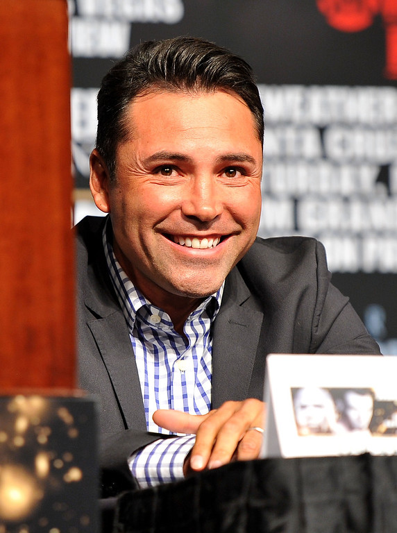 . LAS VEGAS, NV - MAY 01:  President of Golden Boy Promotions Oscar De La Hoya reacts to comments at the final news conference for the bout between Floyd Mayweather Jr. and Robert Guerrero at the MGM Grand Hotel/Casino on May 1, 2013 in Las Vegas, Nevada. Mayweather will defend his WBC welterweight title against Guerrero.  (Photo by Jeff Bottari/Getty Images)