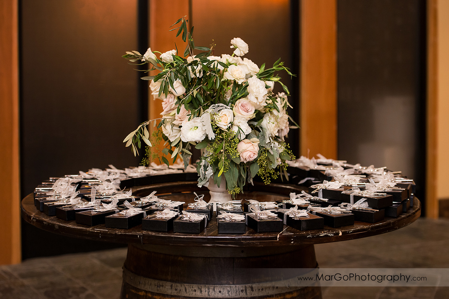wodden table with wedding favors at Livermore Garre Vineyard and Winery