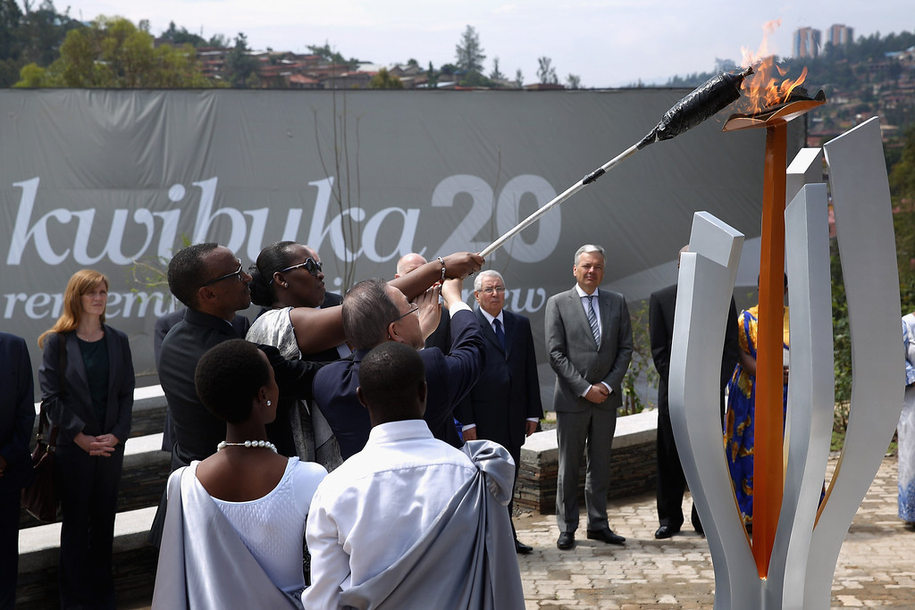 . Rwanda President Paul Kagame, first lady Jeannette Kagame and UN Secretary General Ban Ki Moon light the Flame of Remembrance at the Kigali Genocide Memorial Center on April 7, 2014 in Kigali, Rwanda. (Photo by Chip Somodevilla/Getty Images)
