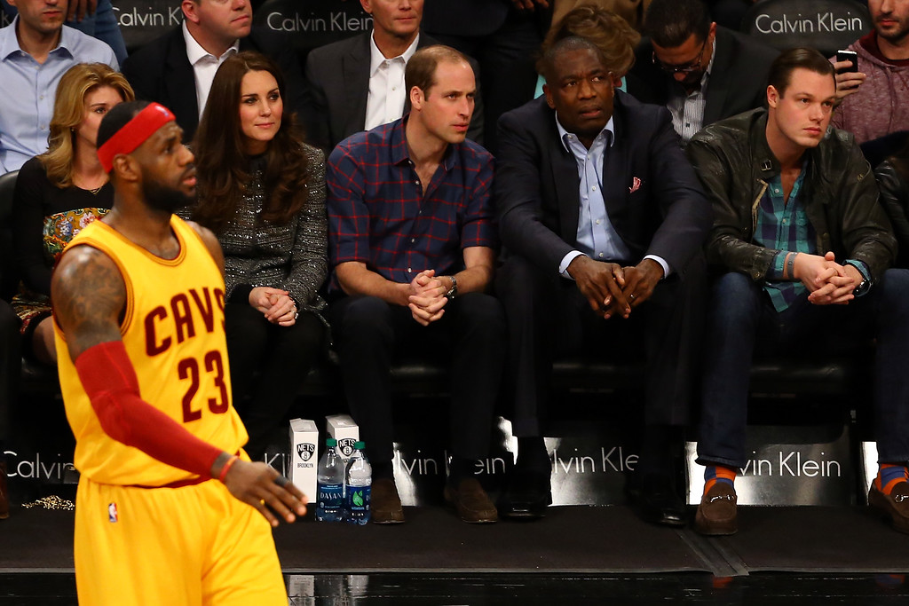 . Prince William, Duke of Cambridge and Catherine, Duchess of Cambridge watch as LeBron James #23 of the Cleveland Cavaliers looks on during his game against the Brooklyn Nets at Barclays Center on December 8, 2014 in the Brooklyn borough of New York City.  NOTE TO USER: User expressly acknowledges and agrees that, by downloading and or using this photograph, User is consenting to the terms and conditions of the Getty Images License Agreement.  (Photo by Al Bello/Getty Images)