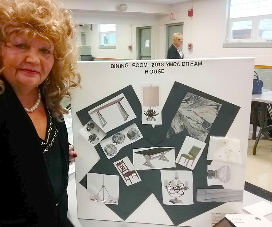 . Design duties for the dining room of the 2018 Lake County YMCA Dream House will be handled by Kathy Snowbrick of Sheraton Furniture in Willoughby. At a recent meeting she presented various elements to be included in the room.  {Jean Bonchak For The News-Herald}