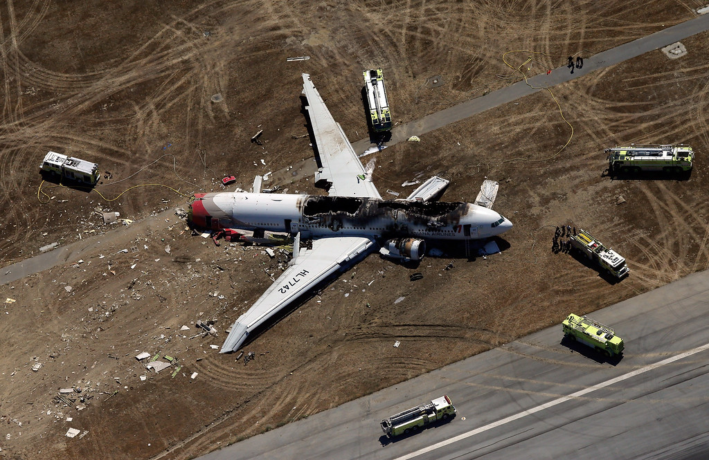 . A Boeing 777 airplane lies burned on the runway after it crash landed at San Francisco International Airport July 6, 2013 in San Francisco, California. An Asiana Airlines passenger aircraft coming from Seoul, South Korea crashed while landing. There has been no official confirmation of casualties. (Photo by Ezra Shaw/Getty Images)