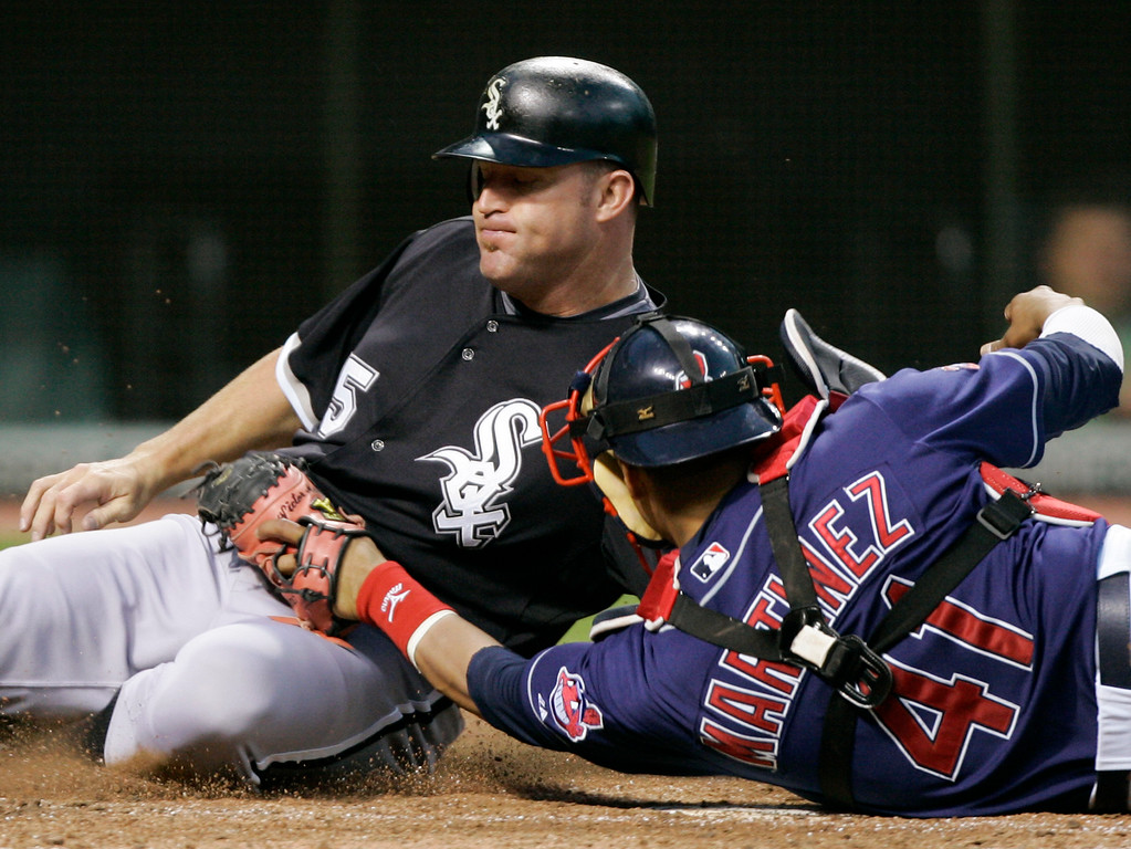 . Chicago White Sox\'s Jim Thome is tagged out at the plate by Cleveland Indians catcher Victor Martinez (41) in the seventh inning of a baseball game Wednesday, July 1, 2009, in Cleveland. (AP Photo/Mark Duncan)
