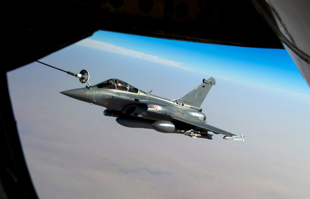 Description of . This photo provided by the ECPAD/French Army shows a Rafale jet fighter refueling over Mali, Tuesday, Jan. 15, 2013.  Islamists in Mali on Wednesday prevented residents from leaving the towns they are holding, and some fear they will be used as human targets by the extremists as French troops pressed forward to launch direct combat within hours. (AP Photo/Adj Nicolas-Nelson Richard, ECPAD, EMA)