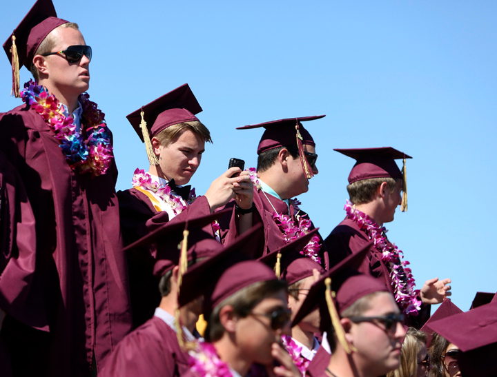 . Graduates snap photos with their smart phones and pose for pictures during the 2013 graduation ceremony at Scotts Valley High on Wednesday. (Kevin Johnson/Sentinel)