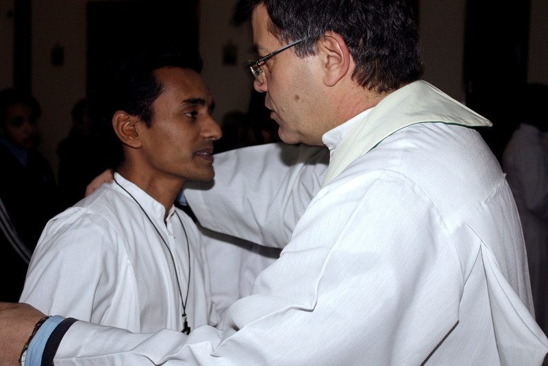Fr. Eduardo, SCJ (Argentina)  presents each with the Final Vow Cross, and offers congratulation.